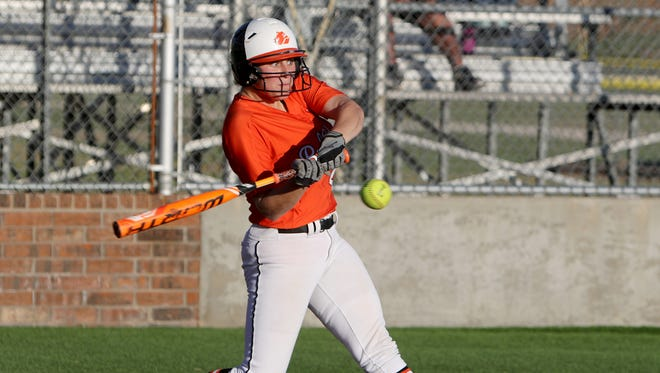 Burkburnett's Faith Hollingsworth hits a three-run homerun in the game against Hirschi Monday, March 27, 2017, at Sunrise Optimist Field 2. The Lady Bulldogs defeated the Lady Huskies 16-1.