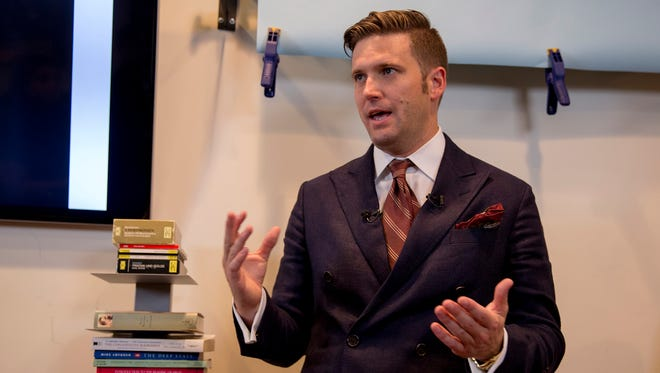 White supremacist Richard Spencer speaks to select media in his office Aug. 14, 2017, in Alexandria, Va. Spencer is speaking at the University of Florida in Gainesville on Thursday, Oct. 19, 2017.