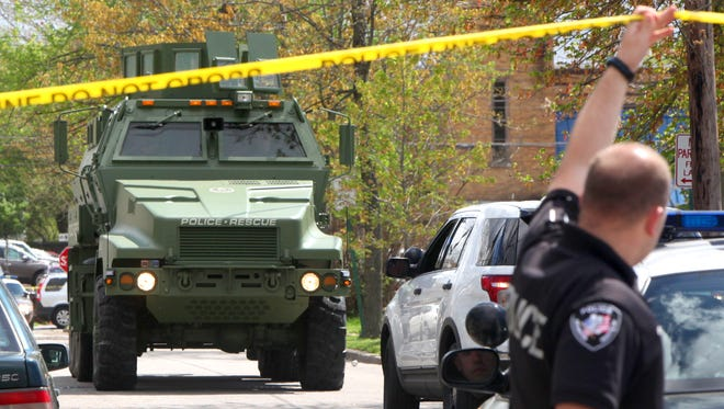 The SWAT team responds after a Lockland man fired at two juveniles and barricaded himself in his house on Monday, April 20.