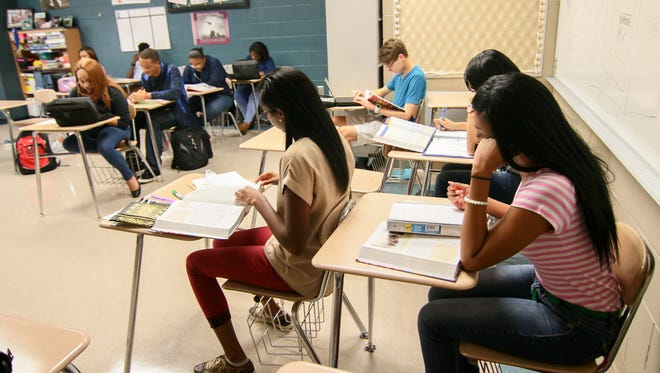 Students in Jamie Bailey's class at T.L. Hanna High School in Anderson study before the end of a school day in August.