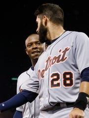Tigers leftfielder Justin Upton, left, and rightfielder J.D. Martinez head to the dugout after scoring on a hit by Cameron Maybin during the sixth inning of the Tigers' 8-3 win over the Twins Tuesday in Minneapolis.