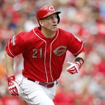 Reds third baseman Todd Frazier runs to first base against the Rockies on May 25.