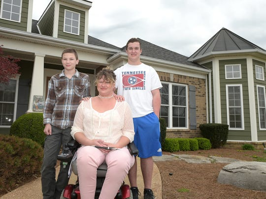 Ten years after saving her sons, Jair,left, and Cole from a tornado that destroyed their Hendersonville home, Amy Hawkins and her family reflect on the day that changed their lives. Hawkins was paralyzed trying to save her two sons following a 2006 Sumner County tornado, The family was featured on Extreme Makeover and will soon be moving out of the home . Ten years after saving her sons from a tornado that destroyed their Hendersonville home, Amy Hawkins and her family reflect on the day that changed their lives. Hawkins was paralyzed trying to save her two sons following a 2006 Sumner County tornado, The family was featured on Extreme Makeover and will soon be moving out of the home .