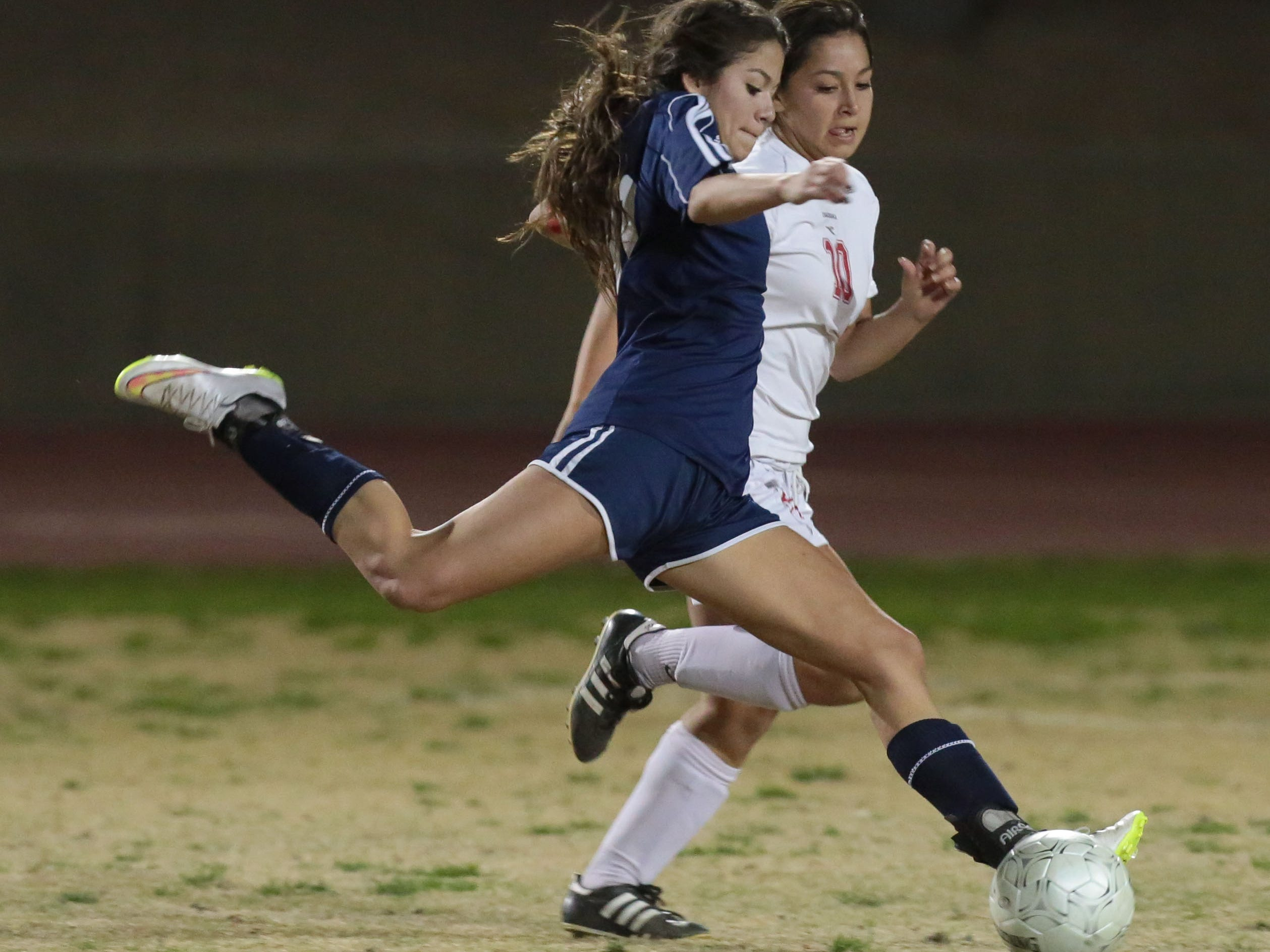 La Quinta's Alieen Galicia and Palm Desert's Alyssa Granados fight for the ball in the first half Wednesday.