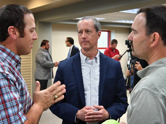 Congressman Mac Thornberry, center, listens to concerns from Adam Wolf, left, and Scott Cleveland on immagration issues that concern rural farmers and producers. Thornberry was attending a roundtable discussion on rural development and broadband infrastructure.
