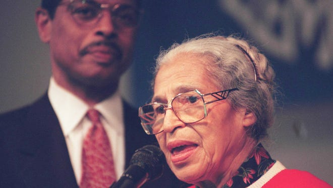 Rosa Parks is pictured in 1996 in a Detroit elementary school appearance. In the background is her attorney, Gregory Reed. Karin Anderson, Detroit Free Press