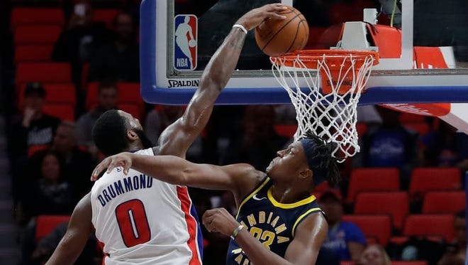Detroit Pistons center Andre Drummond (0) dunks over Indiana Pacers center Myles Turner during the second half of an NBA basketball game, Wednesday, Nov. 8, 2017, in Detroit.