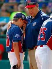 Jackson, N.J, manager Robert Grano, right, comforts
