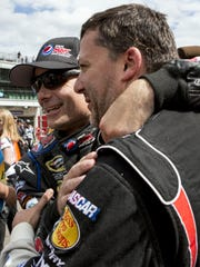 Jeff Gordon, left, and Tony Stewart, right, congratulate each other at the conclusion of the 2013 Brickyard 400.