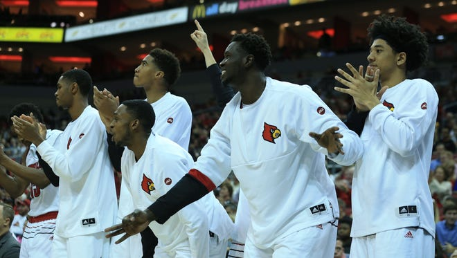 Louisville's Mangok Mathiang cheers with the team bench as the Cards routed Long Beach State Thursday afternoon at the KFC Yum! Center in downtown Louisville. Mathiang finished with 11 points and seven rebounds with two steals.