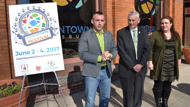 Salisbury Mayor Jake Day, left, announces the city will host the Downtown Salisbury Festival on June 2-4. With him are Ernie Colburn, president and CEO of the Salisbury Area Chamber of Commerce, and Jamie Heater, executive director of the Salisbury Arts and Entertainment District.