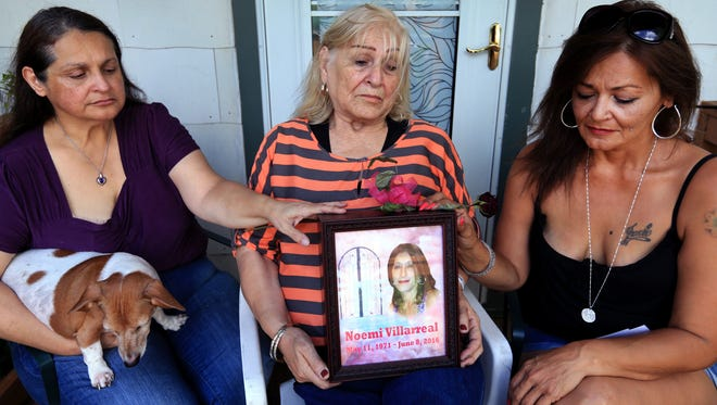 Janie Gatica (from left), Lydia Mu–oz and Nydia Villarreal touch the urn containing the ashes of their sister and daughter, Noemi Villarreal, on Thursday, June 23, 2016. Noemi Villarreal was murdered on June 8, six days after filing a police report against the man charged with her murder.