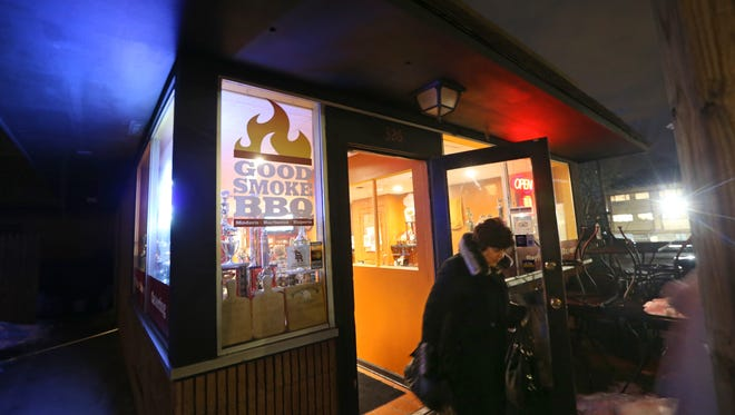 A customer leaves Good Smoke BBQ at 326 W. Commercial St. in East Rochester.