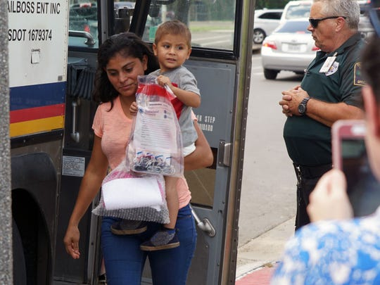 Migrants released from federal custody exit a bus after leaving a federal detention center in McAllen, Texas, on June 22, 2018.