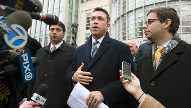 Rep. Michael Grimm speaks to the media outside Federal court in Brooklyn after pleading guilty to a federal tax evasion charge rather than go to trial, on Tuesday, Dec. 23, 2014, in New York. Grimm had been set to go to trial in February on charges of evading taxes by hiding more than $1 million in sales and wages while running a Manhattan health-food restaurant.