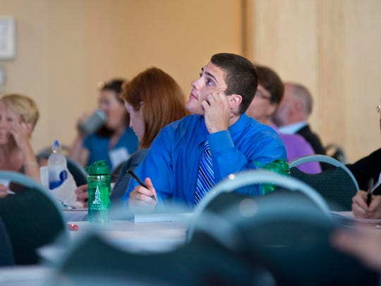 """Nick Hutt of Williston listens to a lecture by Susan Deppe, professor at Auatralian National University, called """"Creating Change: Emotion and Motivation in Restorative Practices and Responsive Regulation"""" during a conference on restorative justice at the University of Vermont in Burlington on Wednesday."""
