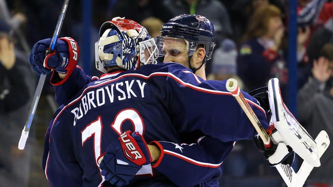 Columbus Blue Jackets goalie Sergei Bobrovsky (72) reacts with left wing Nick Foligno (71) after defeating the Boston Bruins during a 4-3 win on Dec. 27 at Nationwide Arena. The Blue Jackets are one of several teams pondering trade deadline moves.