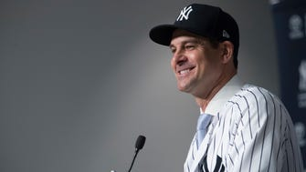 New York Yankees new manager Aaron Boone smiles as he speaks to reporters during a baseball news conference Wednesday, Dec. 6, 2017, at Yankee stadium in New York.