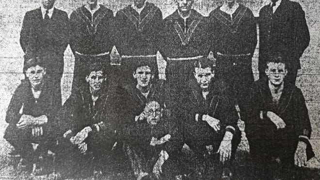 Team photo of the 1931 Pueblo Central High School boys basketbal team. Back row, left to right: Coach Fred Huling, Fred Bode, Mike Milusnic, Sam Mulay, William Sabo, Assistant coach Chick. Front row, left to right: Captain George Kasic, Bruce Litton, Don Lalich, Edward Morehart, Vernon Drain and Mascot Crocombe.