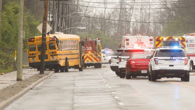 Scene from the crash involving a school bus and two vehicles in Winton Hills on April 23