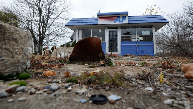 This abandoned gas station at 128 Lexington Ave went to sheriff's sale twice, but no buyers stepped up. It is among Millennium Property Holdings-owned gas stations in 15 Ohio cities which have underground fuel tanks still buried, but which are out of compliance with federal regulations, according to the State Fire Marshal's office.