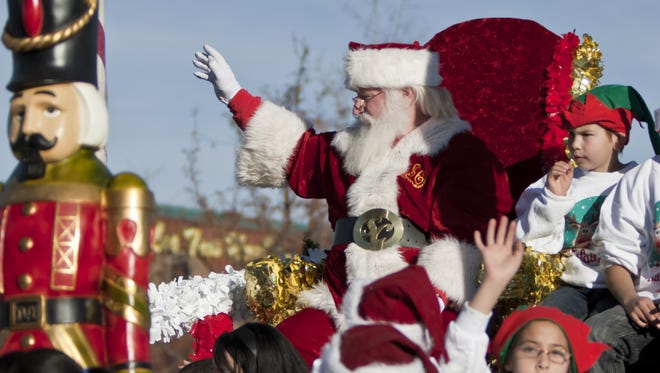 Santa waves to the crowd during the 2012 Sparks Hometowne Christmas Parade along Victorian Avenue in Sparks.