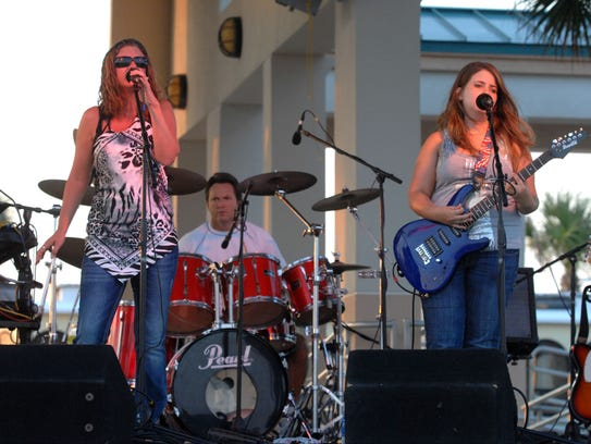 Members of Crosstown perform at Bands on the Beach