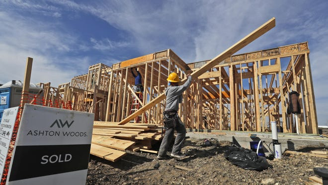 In this Wednesday, Feb. 20, 2019, photo a construction crew works on an already sold new home in north Dallas. On Tuesday, Feb. 26, the Commerce Department reports on U.S. home construction in December. (AP Photo/LM Otero)