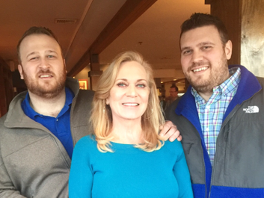 Denise Ely with her sons Evan Ely (left) and Eric Ely (right)