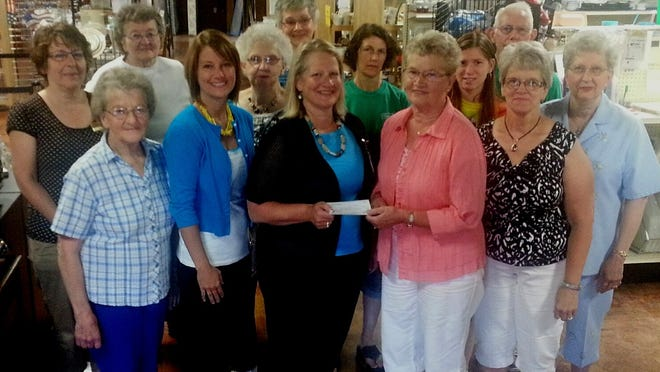 Bargains Galore recently donated $1,500 to Waupun Christian Home & Rehabiliation Center. Bargains Galore store volunteers include, from front left: Carol Thurk, Brenda Hofman, Barbara Wirkus (Christian Home), Alice Posthuma and Carol Jansma. From back row left: Cindy Boone, Marge DeMaa, Georgene Mulder, Ruth Buwalda, Jeannette Winkel, Katie Fiske, Louie Wierenga and Nancy Wierenga.