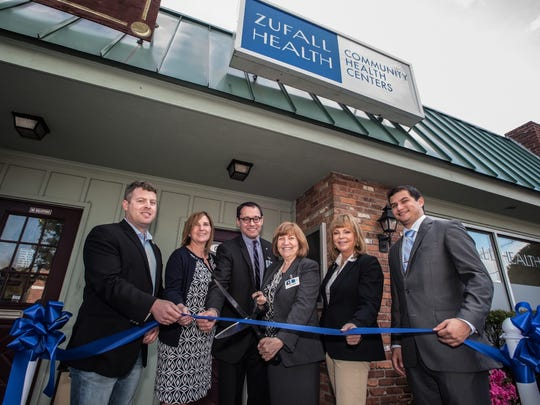 Zufall Health President and CEO Eva Turbiner, third from left, at the recent opening of its newest center in Newton, with guests, from left,  Newton Mayor Dan Flynn; New Jersey Acting Health Commissioner Cathleen Bennett; Bill Shuler, Zufall board chairman; Turbiner,; Assemblywoman Gail Phoebus and Rodrigo Bustamante, representing Rep. Scott Garrett.