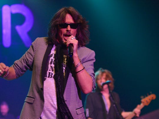 Foreigner lead singer Kelly Hansen led a high-energy concert at Memorial Auditorium Tuesday night.