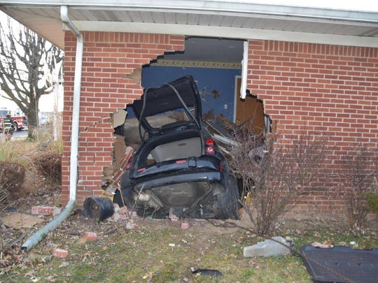 A driver was hospitalized after he crashed an SUV through