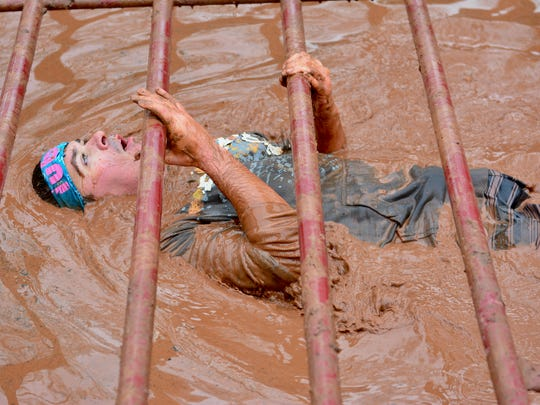 Perhaps the Gauntlet's most difficult obstacle, a contestant pulls his body through a cold muddy moat using the bars. In normal weather, almost all runners do this: the cold led many to walk around the obstacle without shame.
