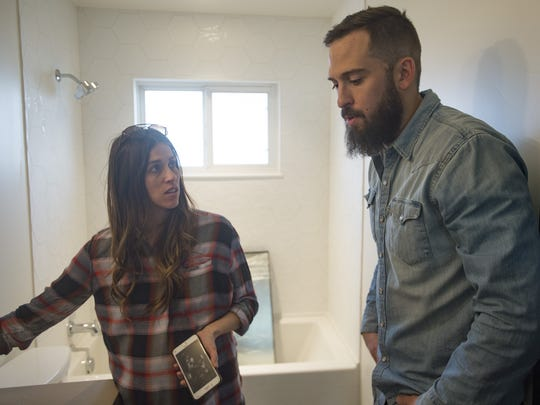 Annie and Jordan Obermann of Forge + Bow discuss the next steps for the bathroom of a home they are renovating on Thursday, Jan. 11, 2018.