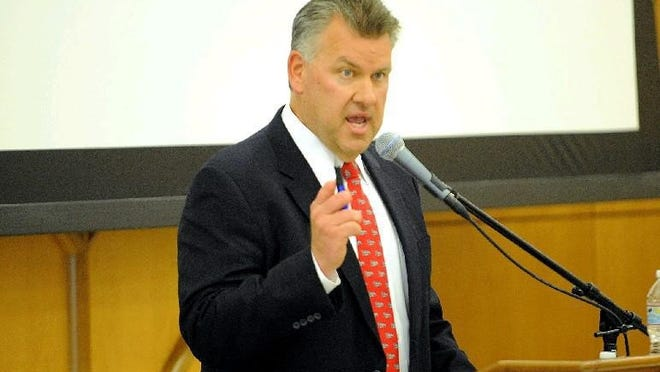 "Wellesley High School athletic director John Brown speaks during the Wellesley High School ""Raider Pride"" sports awards banquet on June 3, 2015."
