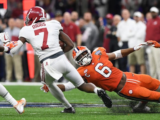 Alabama defensive back Trevon Diggs (7) carries past Clemson linebacker Dorian O'Daniel (6) during the 2nd quarter of the Allstate Sugar Bowl at the Mercedes-Benz Superdome in New Orleans on Monday, January 1, 2018.