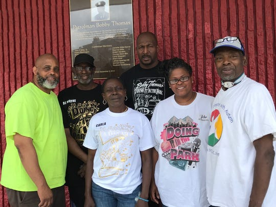 "Committee members of Doing It in the Park event, which was formed to remember the good works of the late Passaic Police Officer Bobby Thomas. They selected Craig ""Ironhead"" Heyward to be this year's honoree."