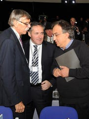 Stephen Wolf, left, and Alfredo Altavilla greet Sergio Marchionne in this file photo.