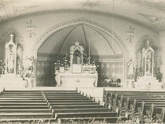 St. Michael Catholic Church, town of Mitchell, circa 1880. The original altars were designed and carved by Peter Glass.