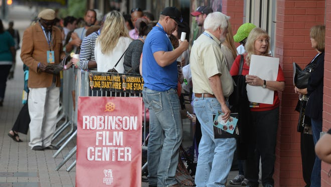A line forms outside the Robinson Film Center for screening of the Louisiana Film Prize.