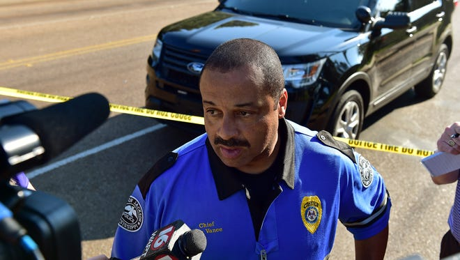 Jackson Police Chief Lee Vance gives an update on the status of a hostage situation at a home at the intersection of McDowell Road and Greenview Drive Thursday.