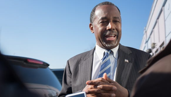 Ben Carson speaks to reporters after stopping at the