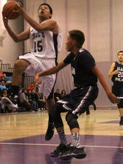 Mescalero's Christian Tsinnijinnie attempts a layup on Saturday night.