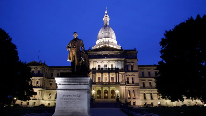 The Michigan Capitol is shown at twilight.