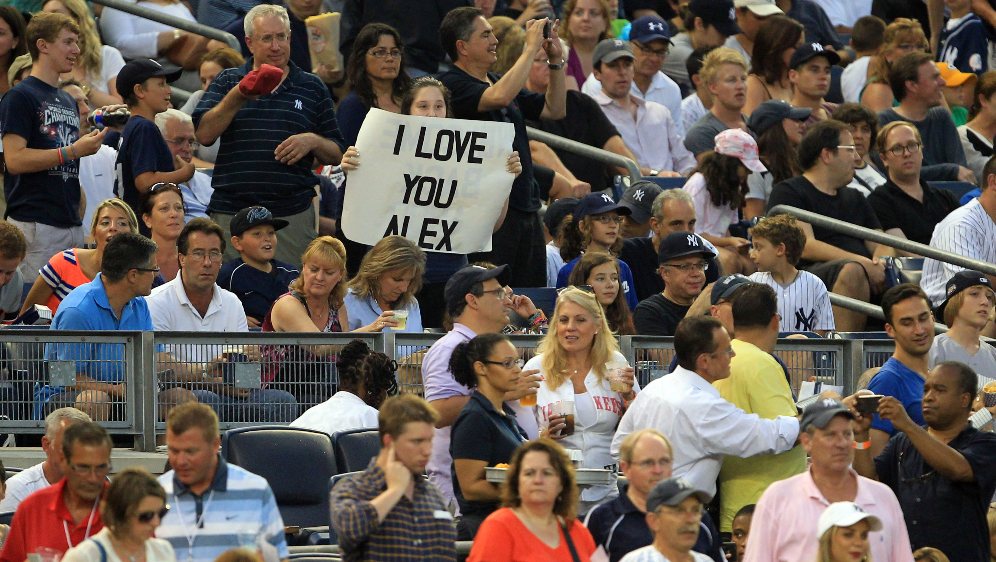 A fan shows support for New York Yankees third baseman Alex Rodriguez during the game against the Detroit Tigers at Yankee Stadium.