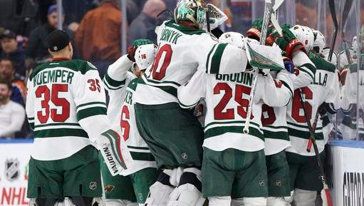 Minnesota Wild celebrate the overtime win over the Edmonton Oilers in an NHL hockey game in Edmonton, Alberta, Sunday, Dec. 4, 2016.