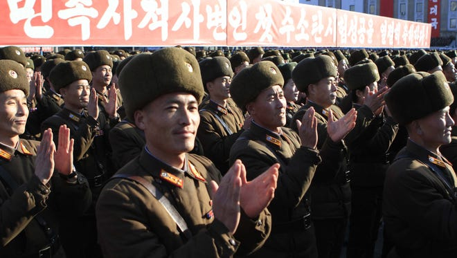 North Korean military personnel celebrate after North Korea said it had conducted a hydrogen bomb test, at the Kim Il Sung Square in Pyongyang, Jan. 8, 2016.
