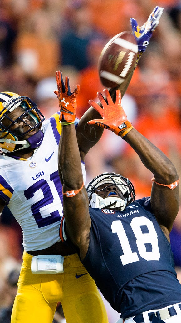Auburn wide receiver Sammie Coates catches a 56-yard touchdown pass as LSU defensive back Rashard Robinson defends him.