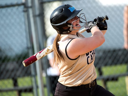 Delone Catholic's Maggie Rickrode watches her two-run home run ball, Wednesday, May 2, 2018. The Delone Catholic Squirettes shutout the York Catholic Irish, 9-0.